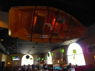 This capsized boat hangs above patrons in the main dining area.